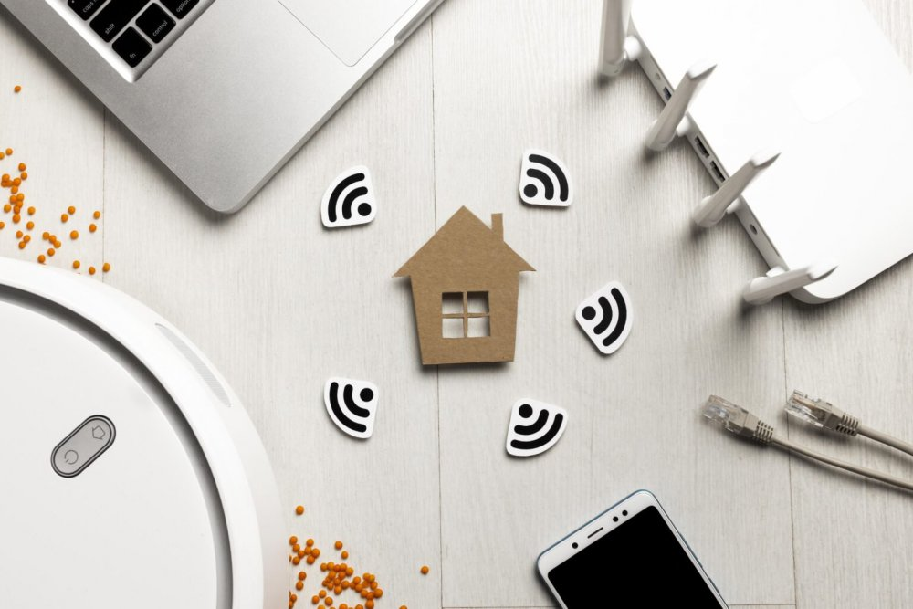 top-view-wi-fi-router-with-house-figurine-wireless-controlled-devices-1536x1024.jpg
